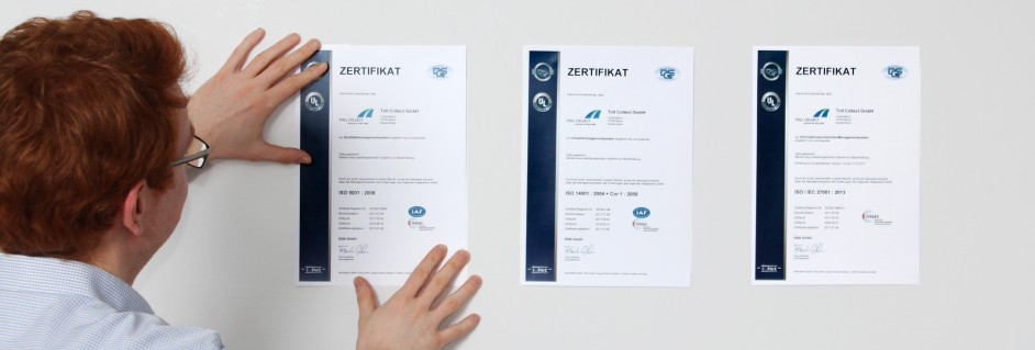 An employee shows Toll Collect certificates confirming high standards